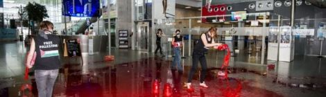 Belgian women pour fake blood in airport to protest Israel arms transport
